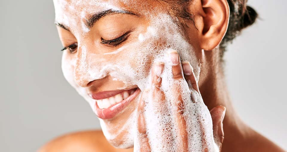 Girl using cleansers