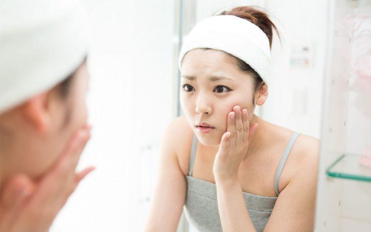 Girls touching her face sensitive skin skincare routine